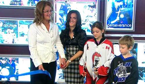 LUC'S MOTHER SUZANNE AND GIRLFRIEND IN FRONT OF TRIBUTE WALL - courtesy of CBC.ca